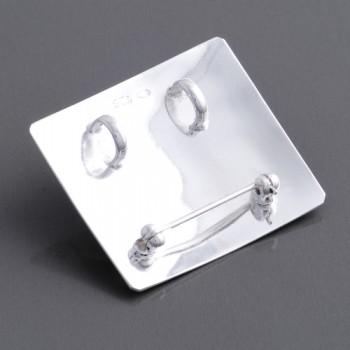 Silberanhänger und Brosche